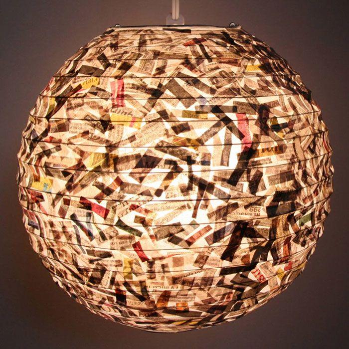 2. Potongan- potongan kertas koran disulap menjadi desain lampu yang unik